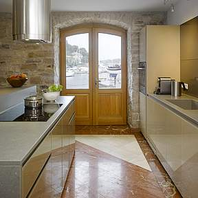 Kitchen opens directly to the seaside terrace