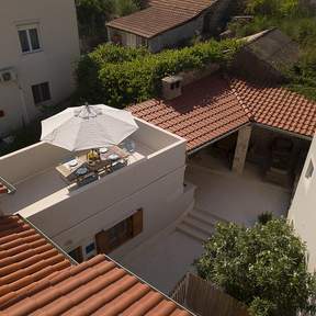 Overview of sun terrace on 1st floor and outdoor patio on ground floor